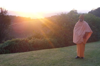 Swami Smarananandaji at sunrise in Drakensburg