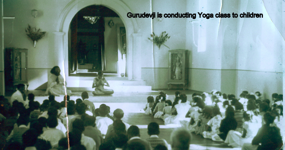 Gurudevji training the children in yogasanas