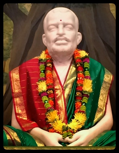 Sri Ramakrishna with beautiful garland